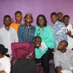Mrs Fayo Williams taking photograph with the trainees