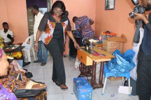 Mrs. Fayo Williams inspecting work done during the shoe making class